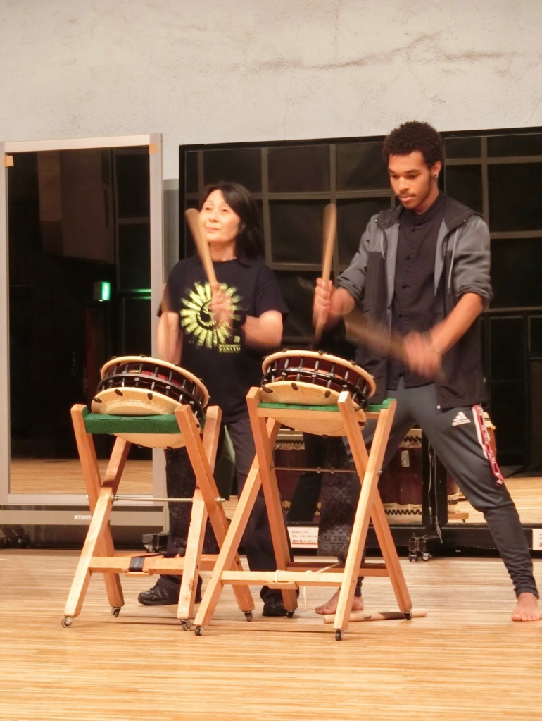 A man and a woman playing Shime Daiko drums